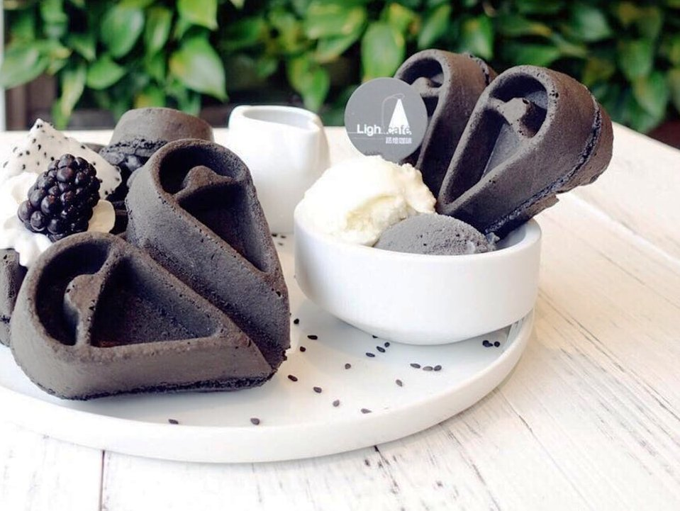 heart shaped Charcoal Black Sesame Waffles at Light Café