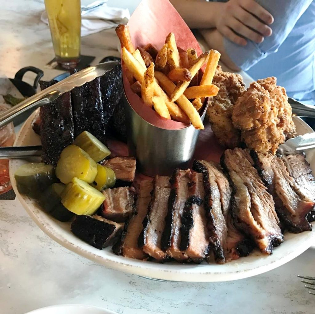 Pitmaster Platter at Carbon Bar which features barbecue ribs, sausage, turkey, and pulled pork